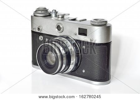 Vintage photo camera of the last century on a white background. The history of the development of photographic equipment and technology