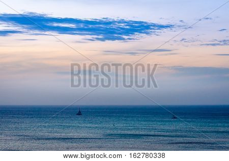 Twilight At Sea With Shipping Boat Silhouette