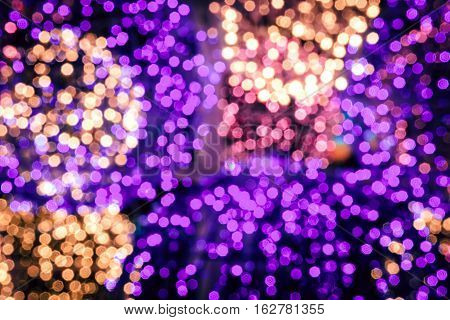 Abstract circular bokeh background against dark background for use at graphic design