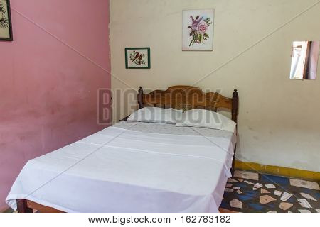 backpacker hostel room with prepared bed in detail