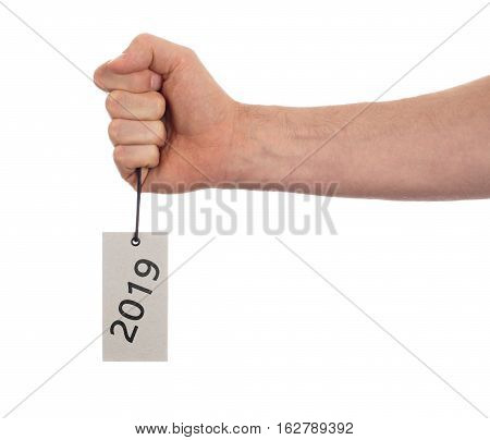 Hand Holding A Tag - New Year - 2019