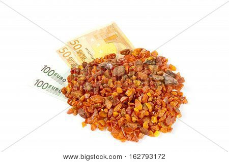 unwrought precious mineral amber and cash Euro banknotes as payment