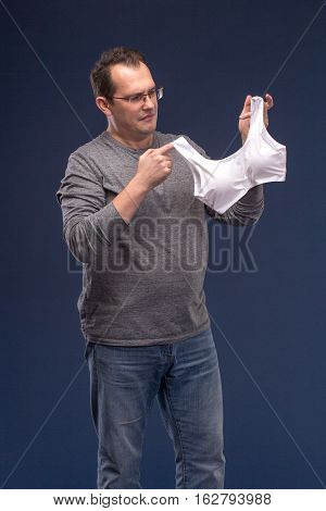Man Holding A Woman's Bra