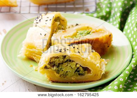 Strudel with broccoli and scamorza .selective focus. style rustic