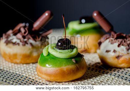 Fresh Tasty Donuts For Hanukkah Celebration On Dark Background