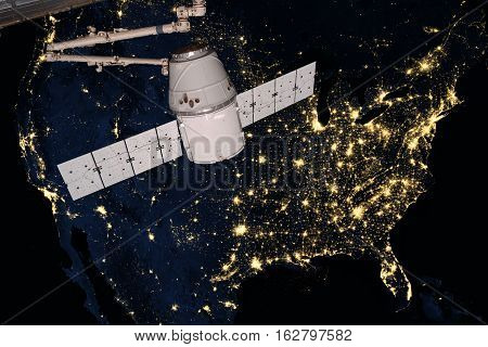SpaceX Dragon orbiting the planet Earth. Elements of this image furnished by NASA.