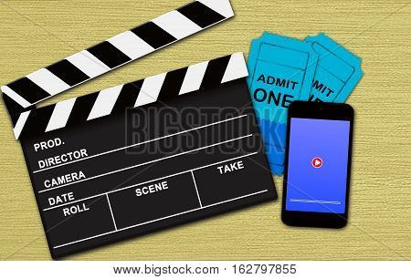 Movie online booking concept on wooden background