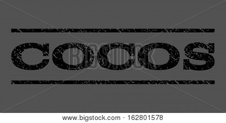 Cocos watermark stamp. Text caption between horizontal parallel lines with grunge design style. Rubber seal stamp with scratched texture. Vector black color ink imprint on a gray background.