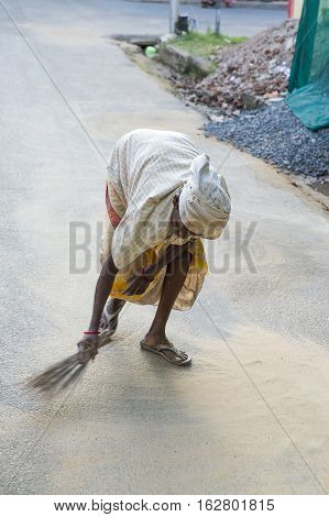 Illustrative image. Pondicherry Tamil Nadu India - July 03 2014. Poor woman worker in small village very hard work for little money roupies