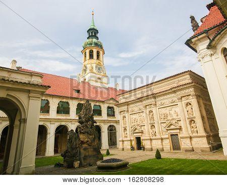 Famous Santa Casa at Loreta a large pilgrimage destination in Hradcany a district of Prague Czech Republic. poster