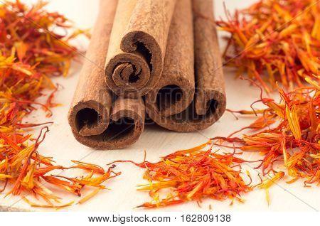 Macro View Of The Sticks Of Cinnamon And Saffron