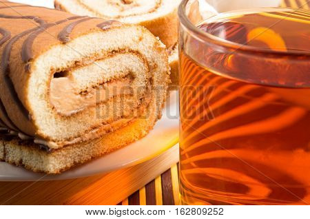 Brown Sponge Cake With Chocolate Filling And Tea