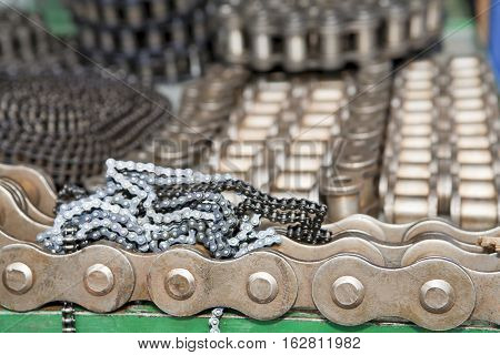 Heap of metal chains industrial abstract background