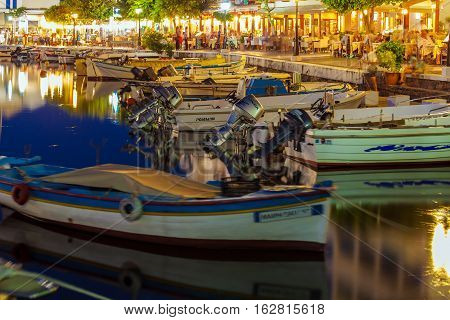 Agios Nikolaos, Crete - July 26, 2012: Tourists Relax In Outdoor Restaurant On The Shores Of Lake Vo