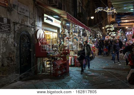 Naples Italy - December 9 2016: The Christmas holiday atmosphere in the heart of the city. San Gregorio Armeno the most famous street in the world for the sale of cribs and commemorative statues.