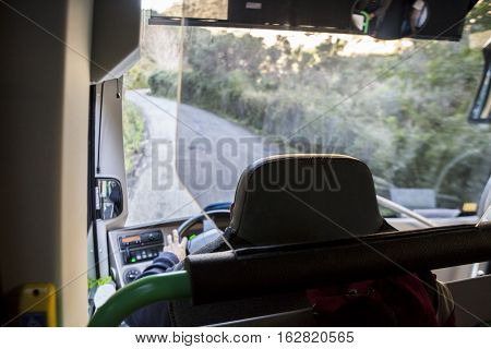 Tourist bus driving on the mountain roads of Gorge of the Gaitanes Malaga Spain