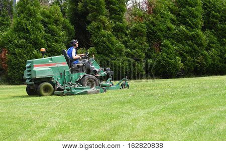 Les Mureaux France - june 24 2016 : a man on a ride on mower