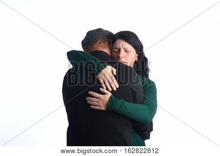 A couple that embraces with tenderness on white background