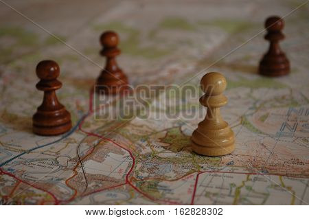 Chess pieces on map depicting strategic planning