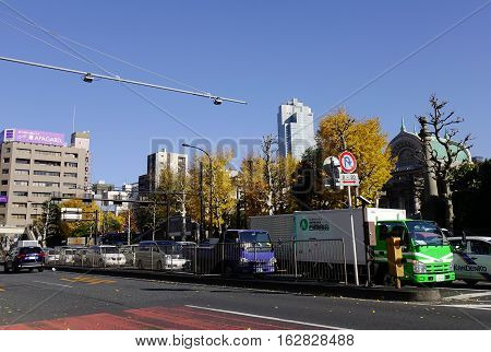 Tokyo Japan - Dec 6 2016. Vehicles running on street at business district in Tokyo Japan. Tokyo has the largest metropolitan economy in the world.