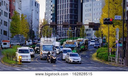 Tokyo Japan - Dec 6 2016. Vehicles running on street at downtown in Tokyo Japan. Tokyo has the largest metropolitan economy in the world.