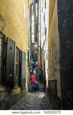 STOCKHOLM, SWEDEN - JUNE 27, 2016: This is one of the oldest narrow alleyways of Gamla Stan.