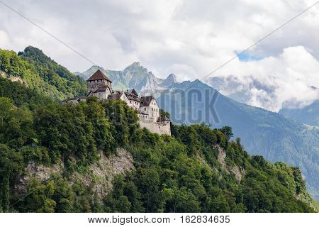 Fairy Vaduz castle Liechtenstein against the background of majestic mountains and clouds - prince residence