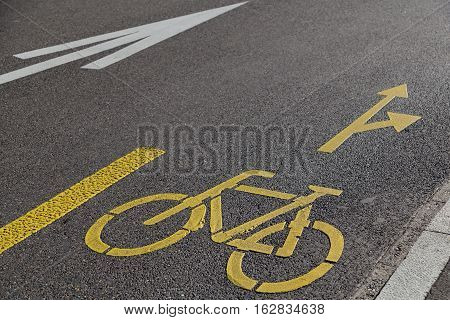 yellow sign bicycle path - road markings on asphalt road