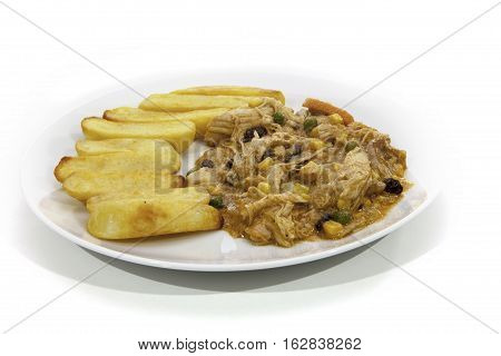 Chicken Korma curry and chunky chips. Typical mixed Indian and English food.