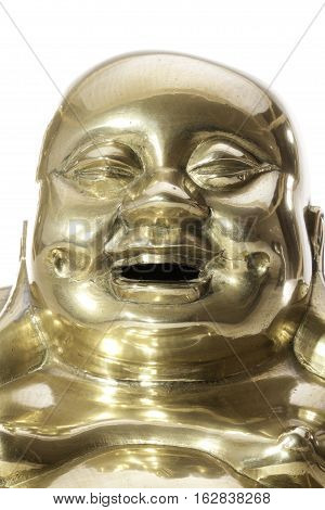 Jolly laughing Buddhist monk face Close up of a traditional brass laughing monk Buddha.