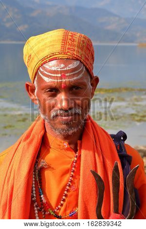 POKHARA, NEPAL - JANUARY 4, 2015: Portrait of a Sadhu or Holy man along the shore of Phewa Lake