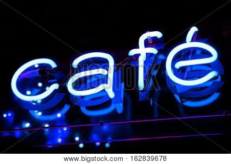 A close-up of a neon Cafe sign.