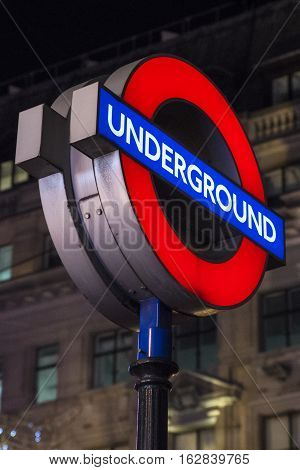 LONDON UK - DECEMBER 20TH 2016: An illuminated sign for an Underground train station in London on 20th December 2016.