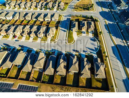 Bird's Eye View Aerial Real Estate Development Sunset Suburban Homes North of Austin near Round Rock , Texas as Texas expands more and more homes are built in Modern Neighborhood Communities