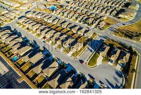Real Estate Aerial View Sunset Suburban Homes North of Austin near Round Rock , Texas as Texas expands more and more homes are built in Modern Neighborhood Communities