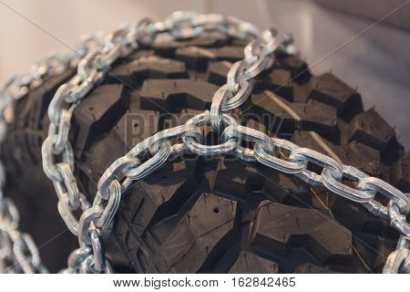 New tires with chains close up. Transport