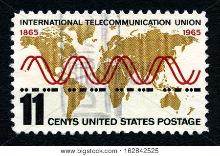 UNITED STATES OF AMERICA - CIRCA 1965: A used postage stamp from the United States of America celebrating the centenary of the International Telecom Union circa 1965.