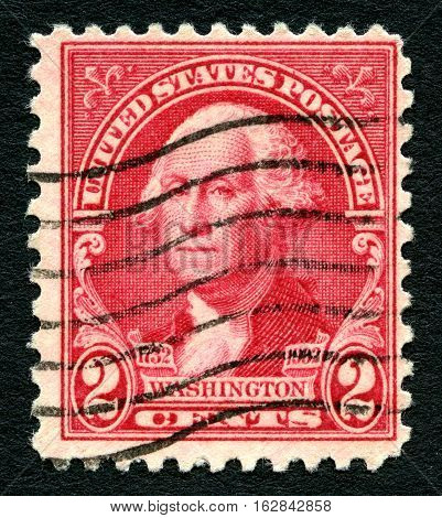 UNITED STATES OF AMERICA - 1ST MARCH 2016: A used postage Stamp printed in America (circa 1914) portraying an illustration of the first President of the USA George Washington circa 1914.