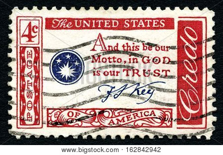 UNITED STATES OF AMERICA - CIRCA 1960: A stamp printed in America displaying the official motto of the USA by Francis Scott Key