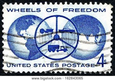 UNITED STATES OF AMERICA - CIRCA 1960: A used postage stamp from the United States of America celebrating the Wheels of Freedom circa 1960.