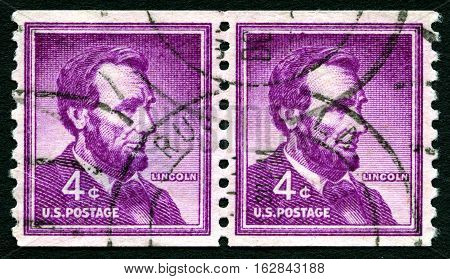 UNITED STATES OF AMERICA - CIRCA 1954: A used postage stamp from the USA depicting an illustration of historic American President Abraham Lincoln circa 1954.