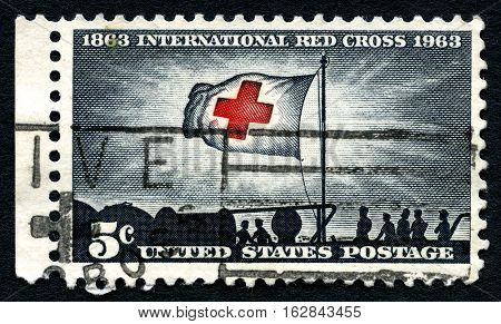 UNITED STATES OF AMERICA - CIRCA 1963: A used postage stamp from the USA celebrating the 100th Anniversary the International Red Cross circa 1963.