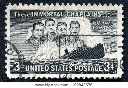 UNITED STATES OF AMERICA - CIRCA 1948: A used postage stamp from the USA issued on the 5th Anniversary of the sinking of the SS Dorchester and commemorates the lives of the Four Chaplains who died circa 1948.