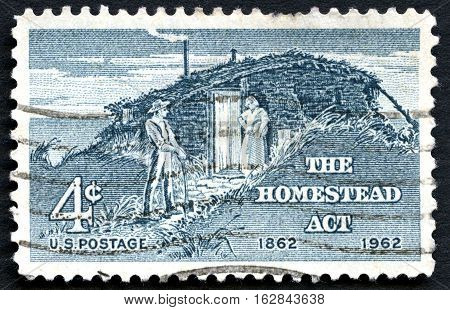 UNITED STATES OF AMERICA - CIRCA 1962: A used US postage stamp commemorating the 100th Anniversary since the 1862 Homestead Act circa 1962.