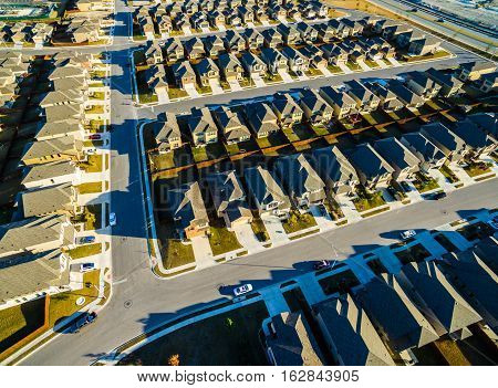 Afternoon Long shadows Suburban Homes North of Austin near Round Rock , Texas as Texas expands more and more homes are built in Modern Neighborhood Communities Bird's eye view