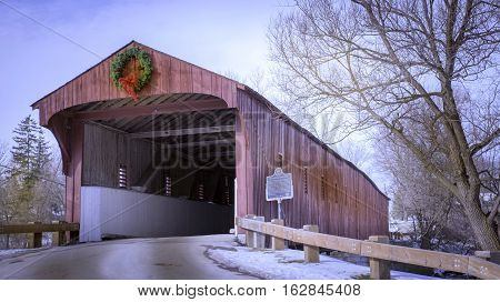 WEST MONTROSE, CANADA - JANUARY 7, 2016: This covered bridge is the only remaining such bridge in Ontario. Built in 1881, it was initially all-wood construction. Over the years it has undergone transformations to strengthen and preserve its integrity. It