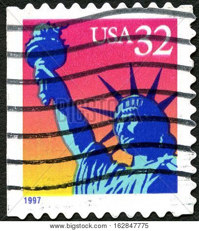 UNITED STATES OF AMERICA - CIRCA 1997: A used postage stamp from the USA depicting an illustration of the Statue of Liberty circa 1997.