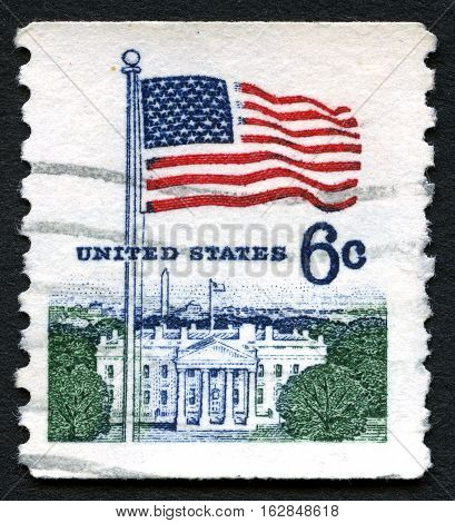 UNITED STATES OF AMERICA - CIRCA 1968: A used postage stamp from the USA depicting an illustration of the White House and American flag circa 1968.