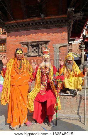 KATHMANDU, NEPAL - JANUARY 14, 2015: Portrait of Three Sadhus (Holy man), one woman and two men in Durbar Square