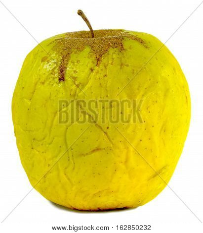 old wrinkled dull yellow-green apple isolated on white background
